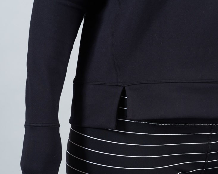 cutout hem of black sweatshirt