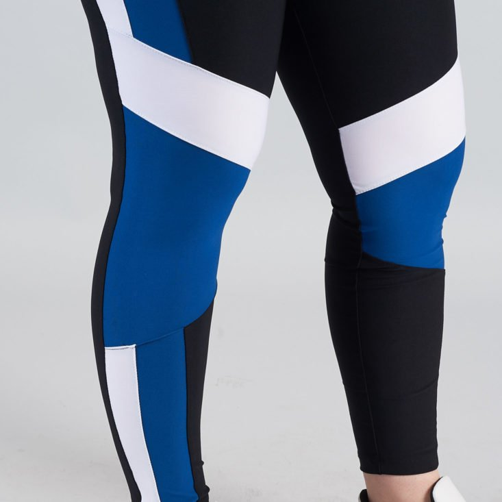 close up on blue and black leggings detail
