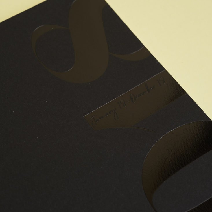 close up of black 2018 cloth and paper planner