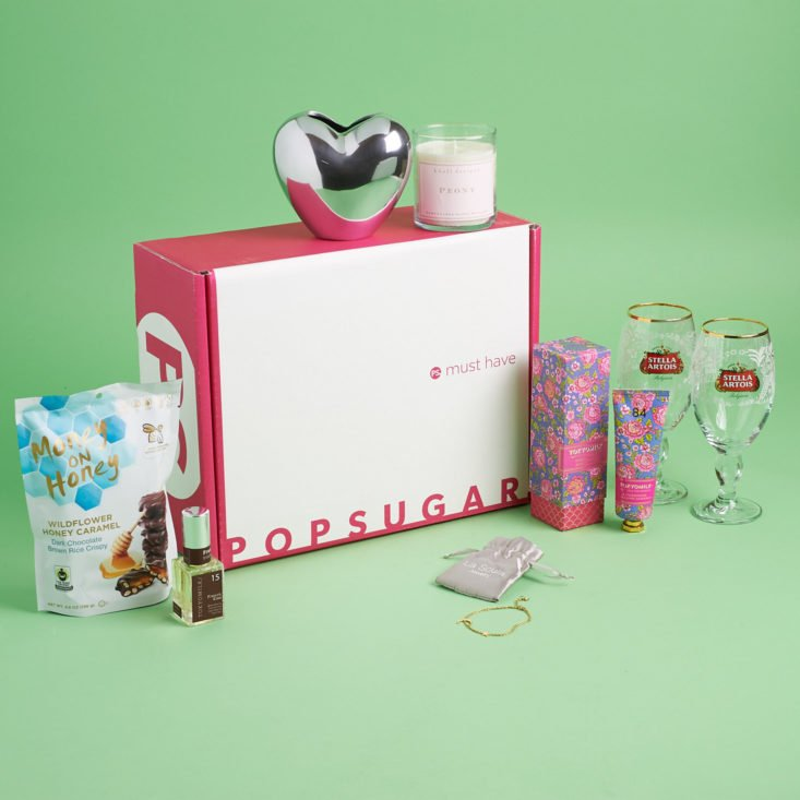 popsugar box and contents including glasses decor and beauty products