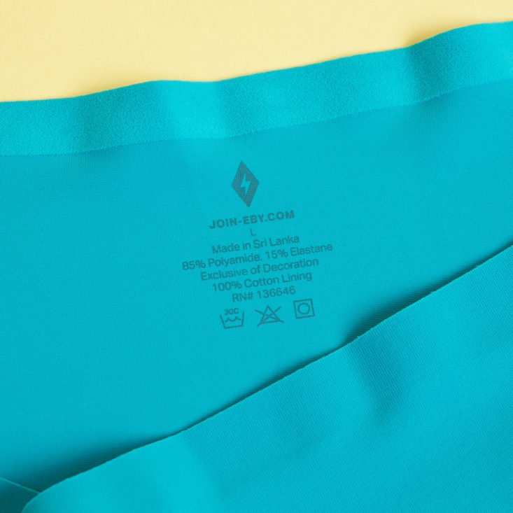 close up of printed tag for EBY Turquoise briefs