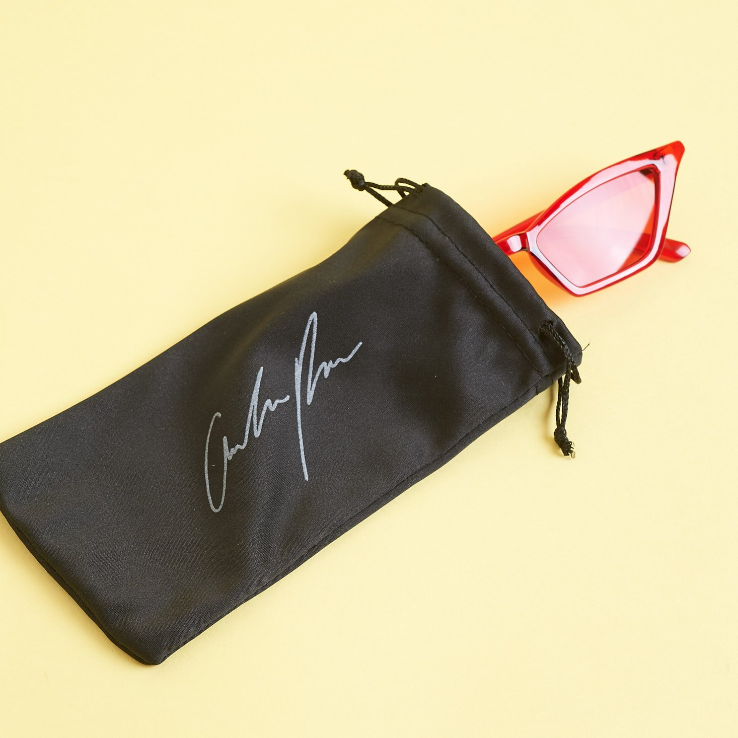 Amber Rose Sunglasses coming out of black pouch