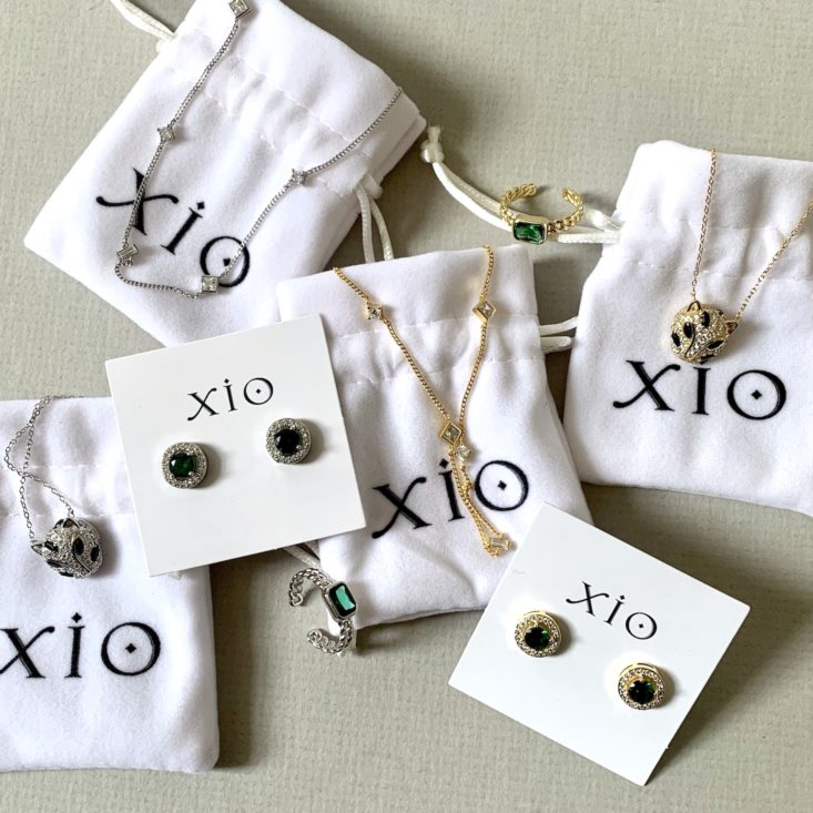 Monthly XIO Bag jewelry pouches and rhinestone-encrusted jewelry.